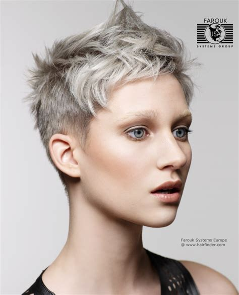 short silver blonde hair short crop silver metallic hair color with a hint of blue