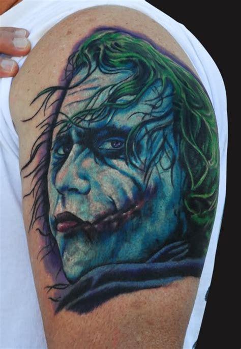 joker tattoo shoulder laughing joker tattoo on man right shoulder