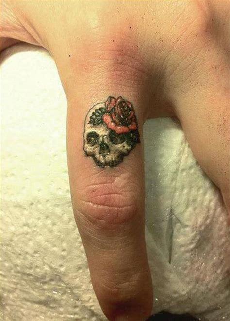 rose ring tattoo 50 exles of finger tattoos golfian