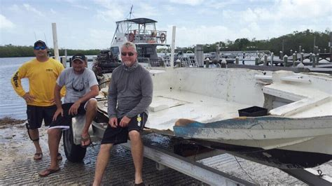 boat salvage key largo sunken fishing skiff removed from protected coral reef off