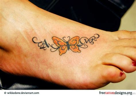 yellow butterfly tattoo 74 delightful butterfly tattoos on foot