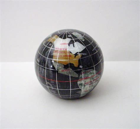 of pearl gemstone inlaid world globe paperweight