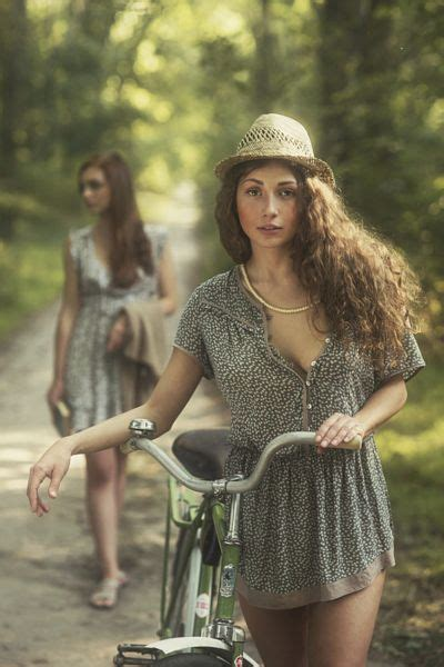 women nudge in ga young girl on a bicycle by david dubnitskiy
