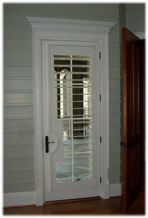 Plantation Shutter Closet Doors Plantation Shutter On Door With Lever Cut Out And Pediment Jpg Door Applications
