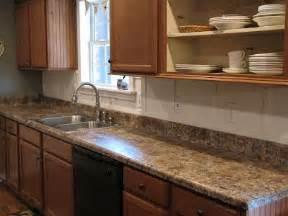She painted her laminate countertops to look like granite