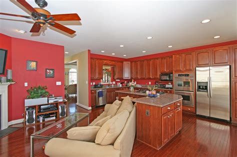Kitchen Family Room Combo by Expansive Family Room Open To The Kitchen And The Back Deck