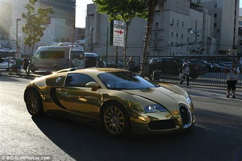 gold bugatti foxx pulls up to premiere in gold bugatti veyron