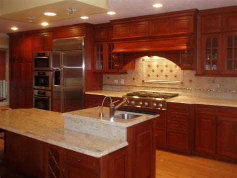ivory backsplash with cherry cabinets coffee machine