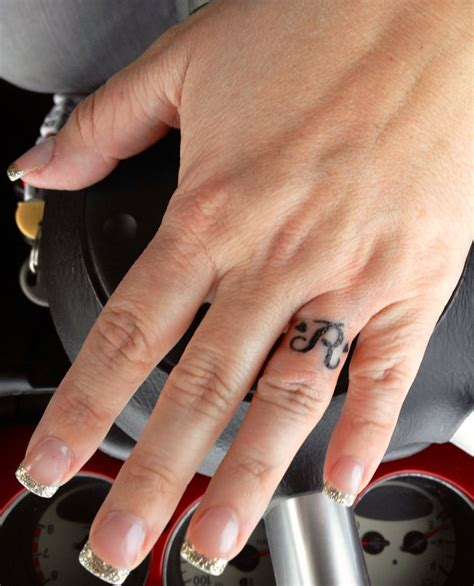 tattoo initials finger hubby s initial with hearts wedding quot ring quot tattoo