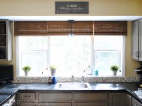 large kitchen window treatment ideas outside mount bamboo shades they share the wood in