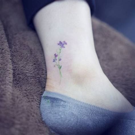 watercolor tattoo violet watercolor style sweet pea flower on the ankle