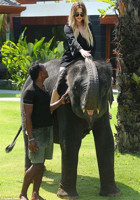 kim kardashian and elephant kim kardashian reveals inflated beach bum in tiny bikini