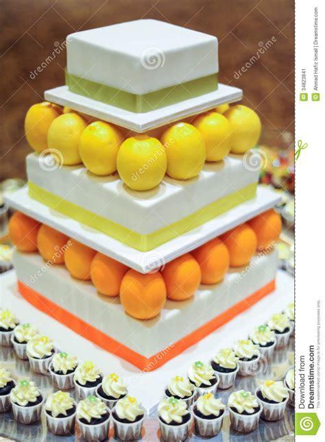 Orange Lemon 3 Tier White Wedding Cake With Mini Cupcakes