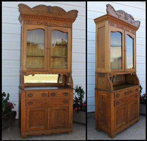 antique ornate oak carved china break front cabinet