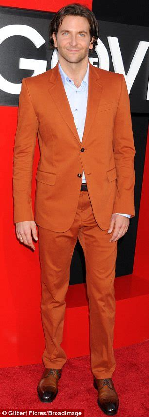 Orange suit while justin also took a risk in a plaid suit with polka
