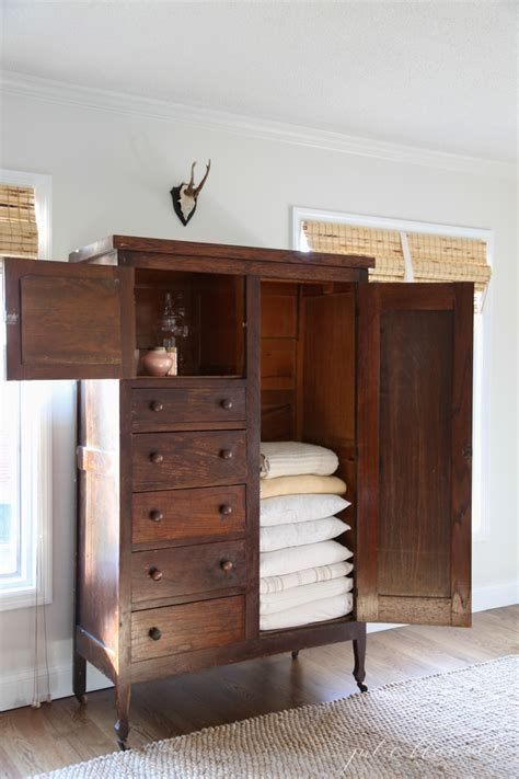 linen armoire cabinet linen cabinet family room organization julie blanner