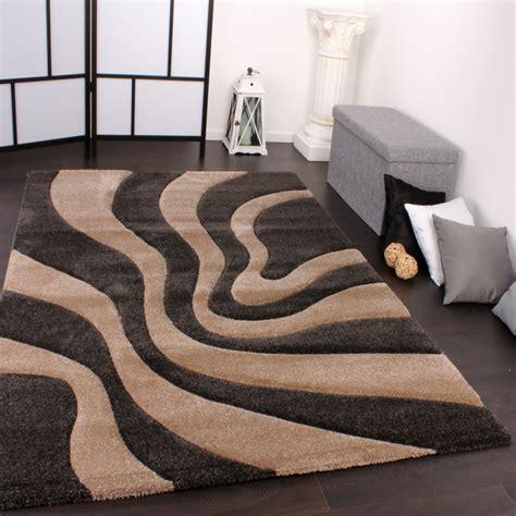teppich schwarz beige designer teppich festival mit konturenschnitt muster