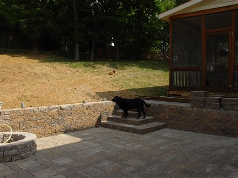 how to build retaining wall on sloped backyard question about re landscaping my backyard building a