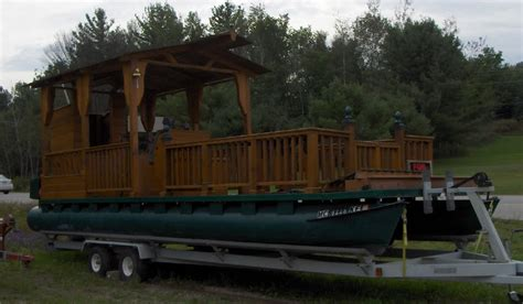 Cabin Pontoon Boat by Pontoon With Wood Elements Floating Cabin