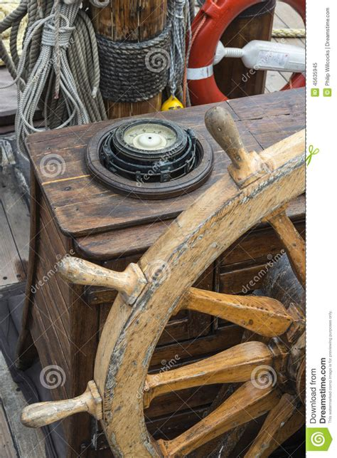 old boat compass ships compass and wheel stock photo image 45635945