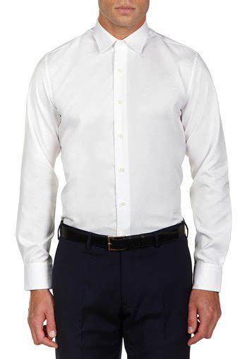 Kemeja Dress White dressing sharp and casual for the in his 30s