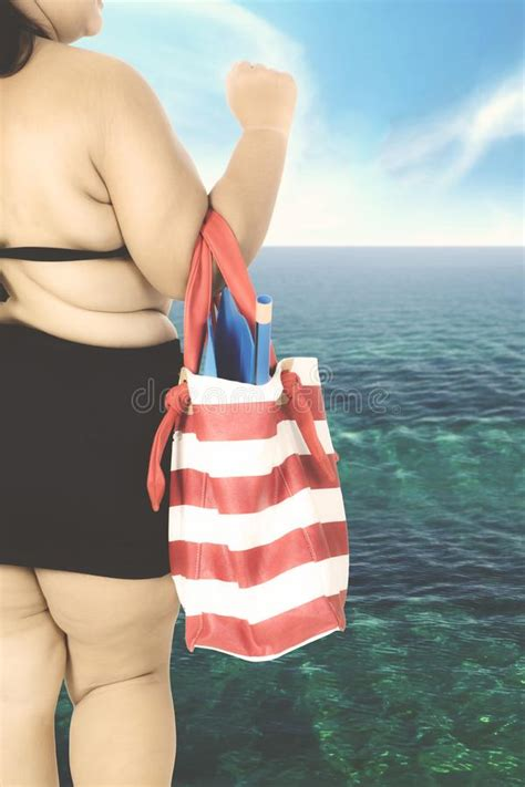 Coast Into Summer With The Handbag by Carrying Summer Bag At Coast Stock Image Image Of