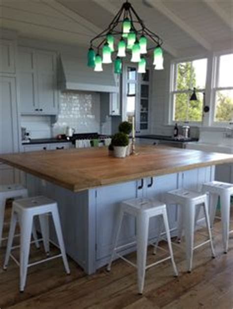 incorporating the spirit of southern decor into your home kitchen island lights barn door ship lap beams home