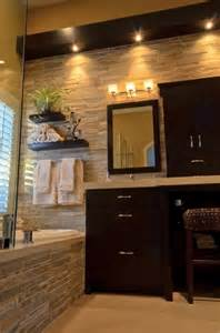 Stone Bathroom Design Ideas by Stone Wall In Bathroom Dark Wood Cabinets Home