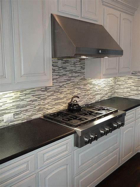 backsplash for black granite and white cabinets black pearl leather granite countertops with a mosaic