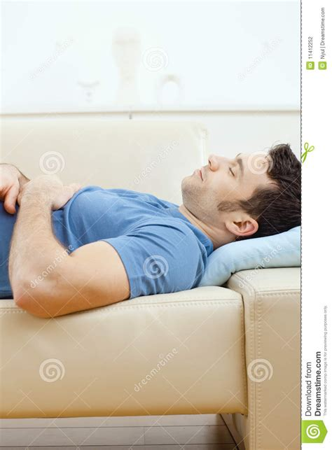 sleeping on a couch man sleeping on couch stock photography image 11412252