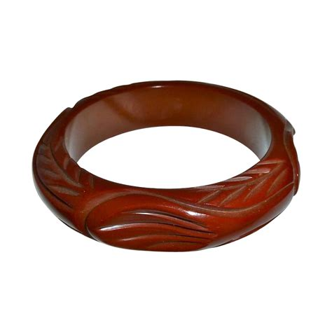 art deco chunky carved bakelite bangle bracelet from