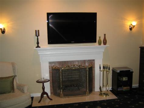 tv above fireplace where to put cable box mounting tv above fireplace cable box 29 images of