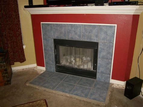 Painting Cabinets Cost Candi In Texas Refinishes Her Tile Fireplace Surround
