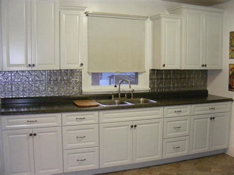 metal backsplashes for kitchens white transitional kitchen staggered wall cabinets metal