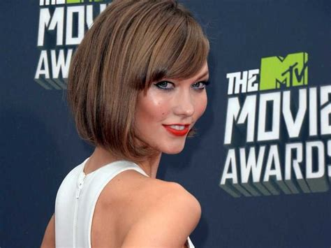 victoria secret model with short hair on the side and the back but long hair on the top karlie kloss signature angled bob natural dark blonde