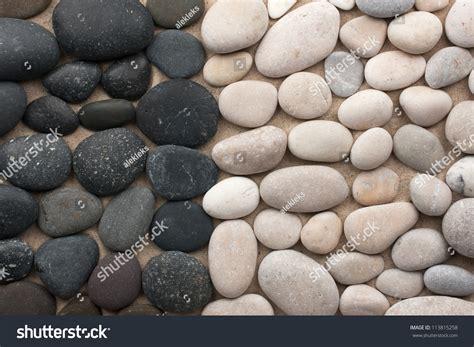 black white stones lie side  stock photo