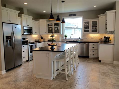 black pearl granite with white cabinets whitekitchen glassfrontcabinets leathered black pearl