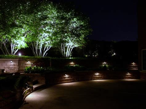 outdoor wall and tree lighting traditional landscape