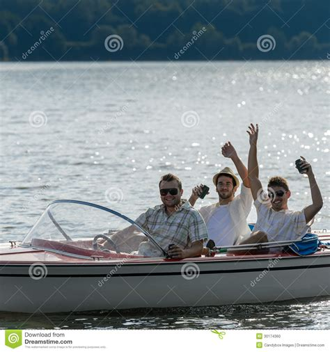 drinking boat cheerful young men drink beer speed boat stock photo