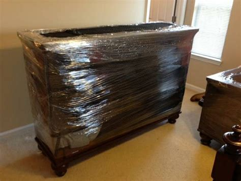 how to shrink wrap a couch our movers will protect your expensive items with
