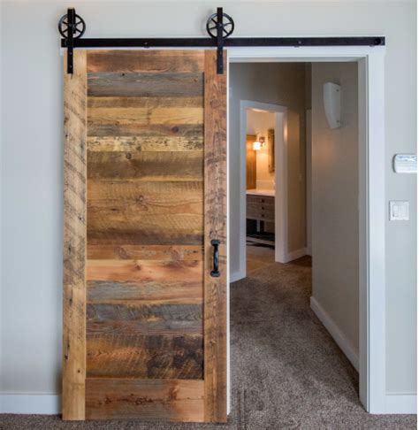 reclaimed wood barn door clear finish on single door