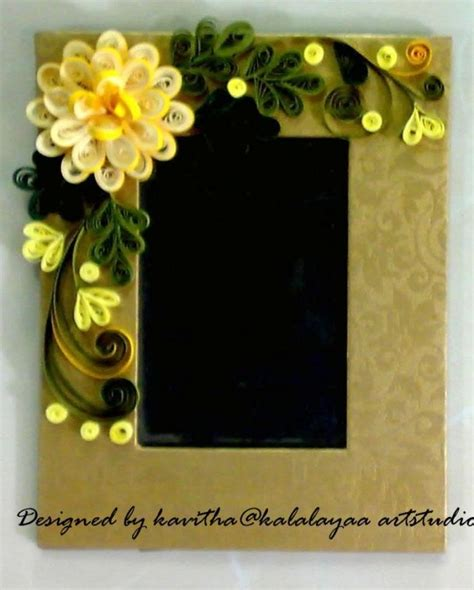 How To Make Paper Quilling Frames - photo frame decorated with quilled flowers n leaves made