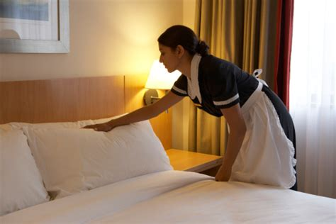 bed making by the staff picture of hotel goldi sands chamber maid working in hotel bedroom stock photo getty