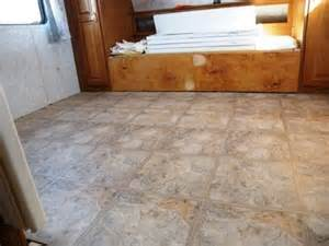 use quarter round to trim all edges after installing floating vinyl tiles on the road