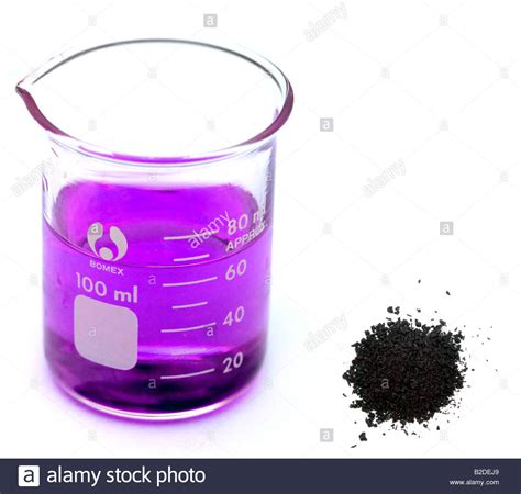 potassium color crystals of potassium permanganate and a beaker containing