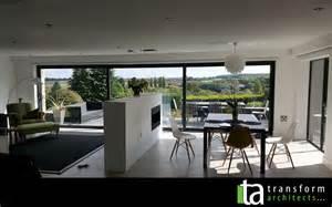 Kitchen Designer Edinburgh open plan living with a triple sliding door transform