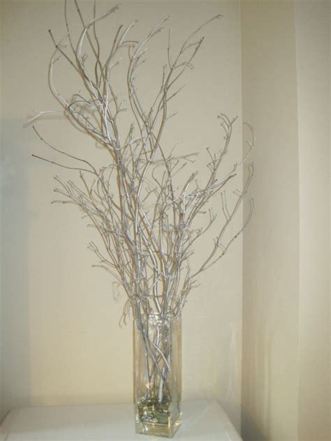 glitter branches for centerpieces winter wedding silver branches weddingbee photo gallery