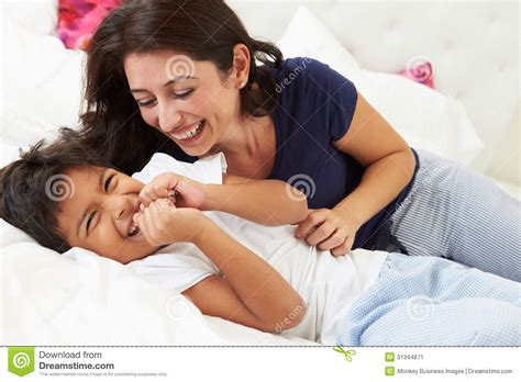 mom son bed mother and son lying in bed together stock image image