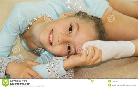 12chan girls little cute girl gymnast doing exercises stock photo