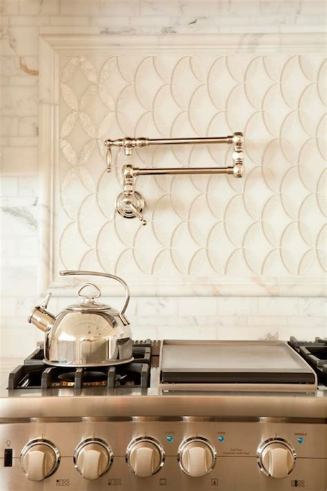 kitchens pot filler tumbled linear stone tiles fish scale tiles transitional kitchen with stainless